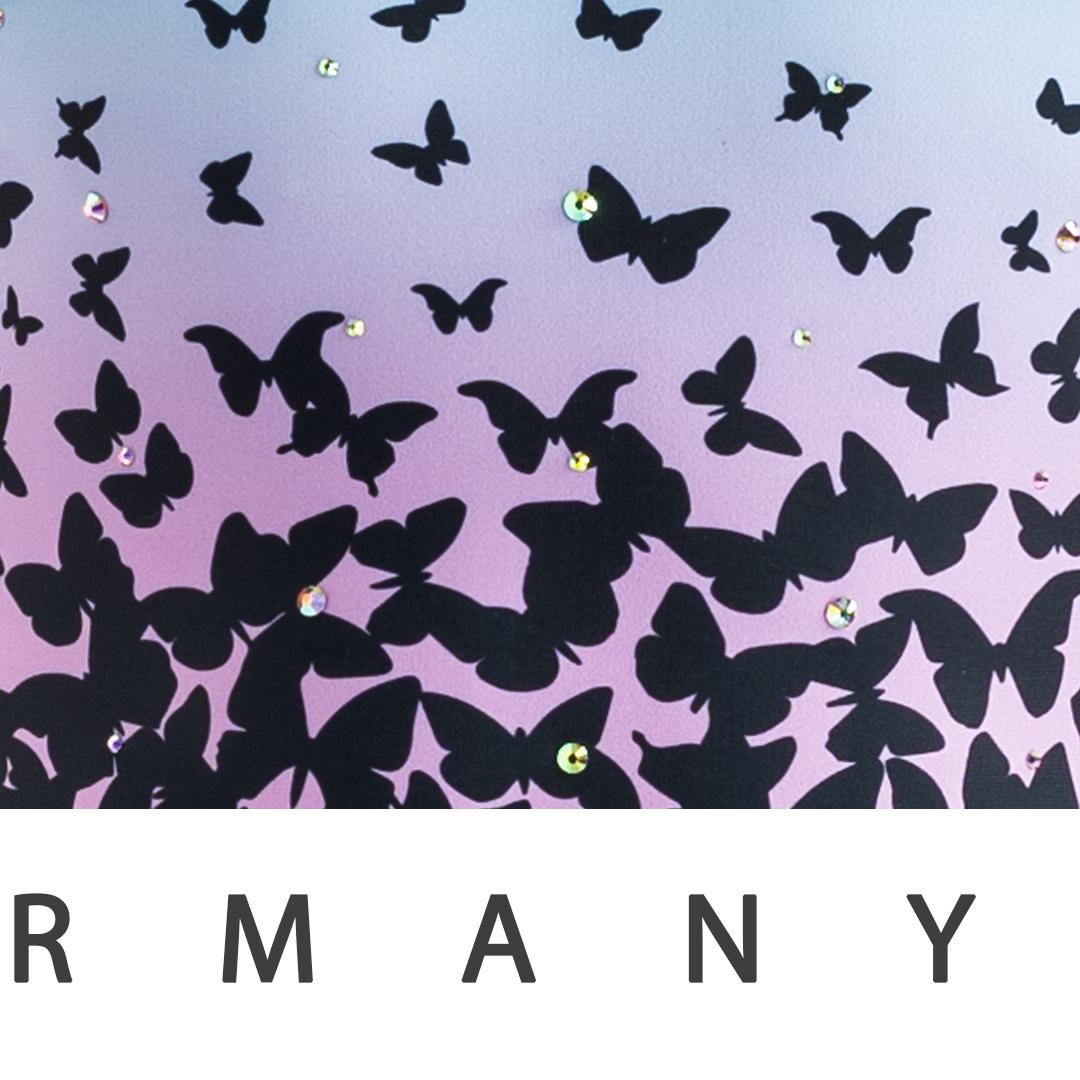 schöner bedruckter Turnanzug mit Schmetterling-Muster und glitzernden Strasssteinen vom deutschen Hersteller ERVY Sports Fashion